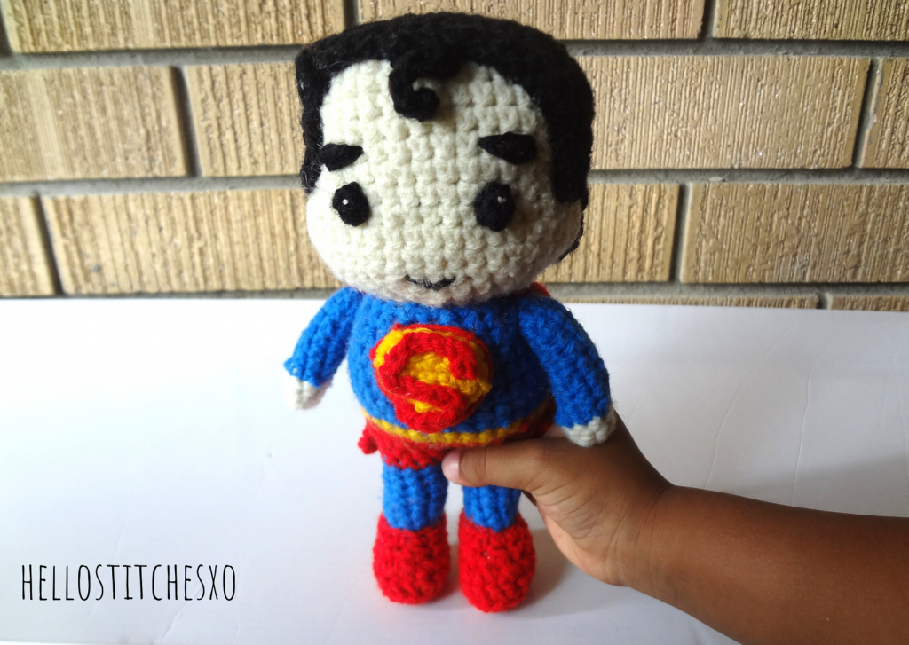 superman amigurumi toy held in hand