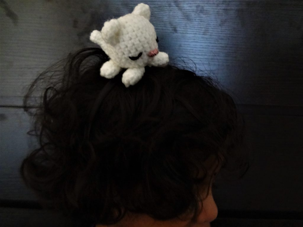 Crochet cat headband on a little girl