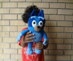 bluey amigurumi toy held in hand